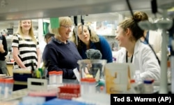 U.S. Sen. Patty Murray visits with lab technician Kennidy Takehara in a research lab at the University of Washington's UW Medicine South Lake Union Campus.