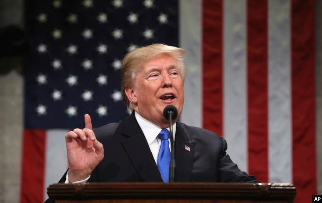 FILE - President Donald Trump delivers his first State of the Union address in the House chamber of the U.S. Capitol to a joint session of Congress, Jan. 30, 2018.