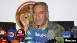 FILE - Khalid al-Obeidi, now ousted as Iraq's defense minister, speaks during a news conference in Baghdad, Dec. 19 2015.