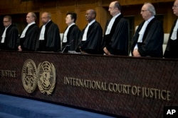 Judges enter the International Court of Justice, or World Court, in The Hague, Netherlands, Wednesday, Oct. 3, 2018, where they ruled on an Iranian request to order Washington to suspend U.S. sanctions against Tehran.