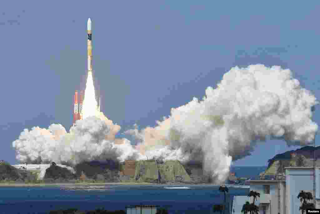 A H-IIA rocket carrying Himawari 8 weather satellite, blasts off from the launching pad at Tanegashima Space Center on the Japanese southwestern island of Tanegashima, in this photo taken by Kyodo.