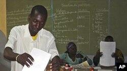 A man cast his ballot during Burkina Faso elections at Ouagadougou, Burkina Faso, Sunday, Nov. 21, 2010.