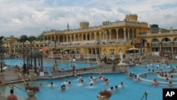 The Neo-Baroque building at Szechenyi Bath and Spa surrounds the outdoor pools, Budapest.