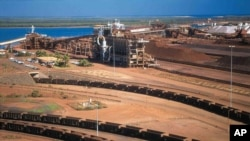 In this undated hand out photo released by BHP Billiton Ltd, shows their iron ore depot in Port Headland, Australia, file photo.