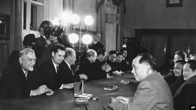 FILE - President Mao Tse-tung, right,  of the Communist Chinese republic and Soviet Prime Minister Nikolai Bulganin, left, of the Soviet Union chat together in Moscow, Nov. 4, 1957.