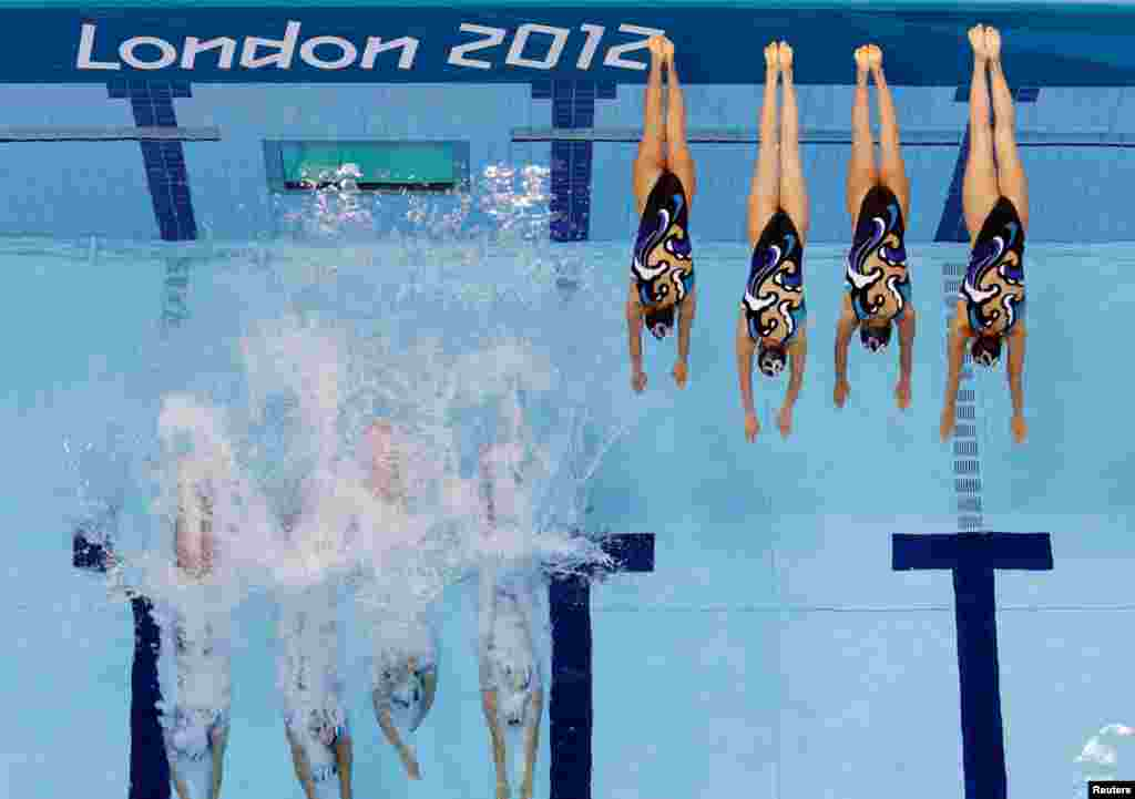 Japan's women's synchronized swimming team start their technical routine.