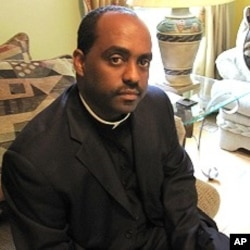 Father Reginald Jean-Marie travels to Haiti almost weekly to help earthquake survivors