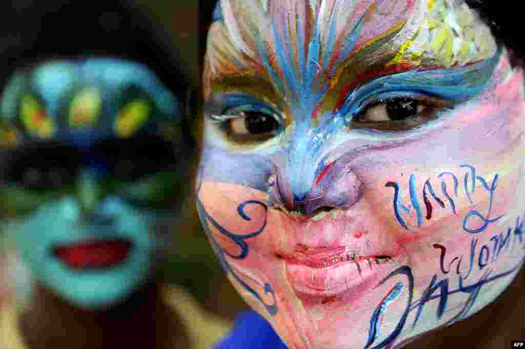 Indian students pose with their faces painted at a college in Chennai ahead of International Women's Day.