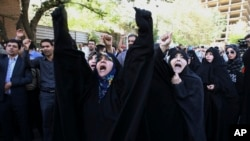FILE - Iranian protesters chant slogans in front of the Saudi Arabian Embassy in Tehran, Iran, Sunday, Sept. 27, 2015.