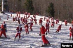 A ski resort in Maine welcomed 150 skiing and snowboarding Santas, Dec. 6, to raise money for charity.
