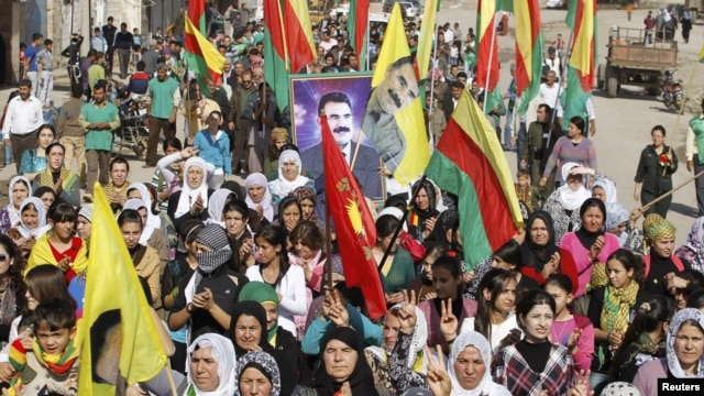 Syrian Kurds demonstrators hold flags and portraits of jailed Kurdistan Workers Party (PKK) leader Abdullah Ocalan during a protest in Derik, Al Hasakah, Syria, November 1, 2012.