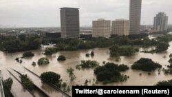 Flooded downtown is seen from a high rise along Buffalo Bayou after Hurricane Harvey inundated the Texas Gulf coast with rain causing widespread flooding, in Houston, Texas, Aug. 27, 2017, in this picture from social media.