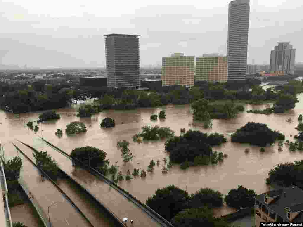 Flooded downtown is seen from a high rise along Buffalo Bayou after Hurricane Harvey inundated the Texas Gulf coast with rain causing widespread flooding, in Houston, Texas, Aug. 27, 2017, in this picture obtained from social media.