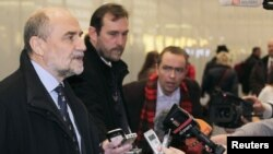 Herman Nackaerts (L) , head of a delegation of the International Atomic Energy Agency (IAEA), speaks to journalists at the airport in Vienna after arriving from Iran, December 14, 2012.