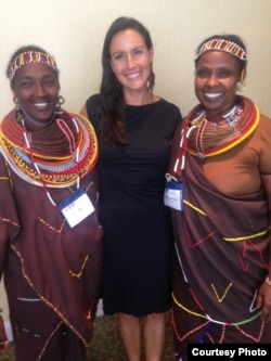 Pearl Gottschalk (C) of Lush Cosmetics, an eco-friendly corporate funder, poses with two women from Kenya's Kivulini Trust, at the World Summit on Indigenous Philanthropy in New York Sept. 26, 2014. (Courtesy - Pearl Gottschalk)