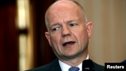 Britain's Foreign Minister William Hague speaks during a news conference in Tripoli, July 16, 2012.