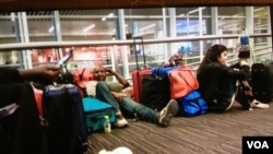 Some of the stranded passengers at Brussels International Airport