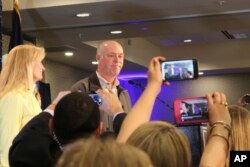 Republican Greg Gianforte greets supporters at a hotel ballroom after winning Montana's sole congressional seat, May 25, 2017, in Bozeman, Mont. In his speech, Gianforte apologized for a altercation at his campaign headquarters with a reporter on the eve of the special election.