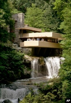Fallingwater, one of the late architect Frank Lloyd Wright's best-known works, hangs over Bear Run waterfall in Big Run, Pa., Aug. 23, 2007.