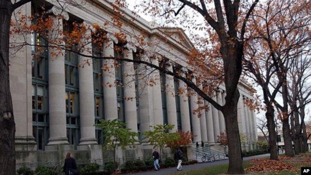 FILE - Students walk through the Harvard Law School area on the campus of Harvard University in Cambridge, Mass.
