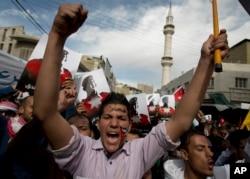 Demonstrators protesting the death of slain Jordanian pilot Muath al-Kaseabeh chant anti-Islamic State slogans during a rally Friday in Amman, Jordan.