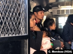 A group of Guatemalan migrants, including five families, waits inside a U.S. Customs Border Patrol truck after being processed at the crossing at El Paso, Texas, April 9, 2019.