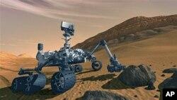 អង្គការណាសាដាក់បង្ហាញរូបភាពជាស្នាដៃរបស់វិចិត្រករម្នាក់អំពី យានឈ្មោះមន្ទីរពិសោធន៍វិទ្យាសាស្ត្រភពព្រះអង្គារ (Mars Science Laboratory) នៅលើភពព្រះអង្គារ។