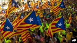Catalans with estelada or independence flags gather during the Catalan National Day in Barcelona, Spain, Sept. 11, 2017.