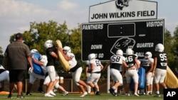 FILE - The Permian High School football team practices Tuesday, Sept. 3, 2019, in Odessa, Texas. (AP Photo/Sue Ogrocki)