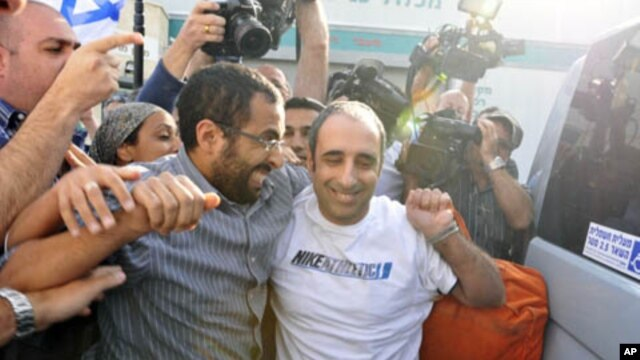 Hagai Amir (R), the brother of the man who assassinated the late Israeli Prime Minister Yitzhak Rabin, rejoices after his release from Ayalon prison, south of Tel Aviv May 4, 2012.