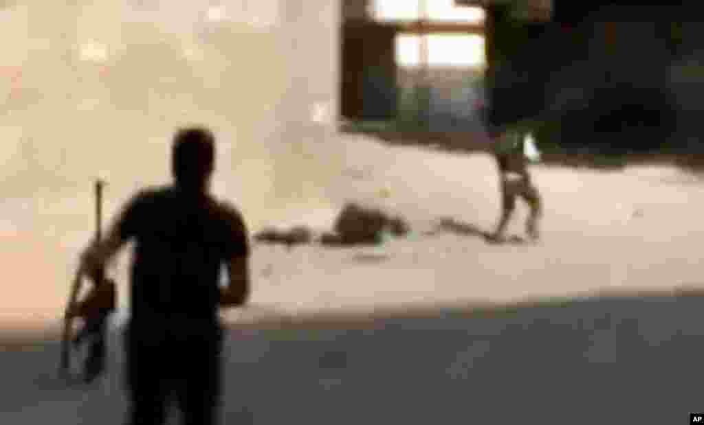 Солдати Вільної сирійської армії під час боїв із урядовими військами у Дамаску.