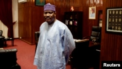 FILE - Former Niger Prime Minister Hama Amadou poses for a picture at his office in the National Assembly in Niamey, Sept.16, 2013.