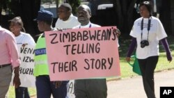 FILE: Zimbabwean journalists take part in a march to commemorate World Press Freedom Day in Harare.