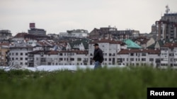 A man walks on the site where the Belgrade Waterfront project will be built, March 27, 2015.