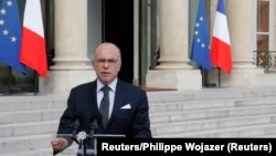 French Interior Minsiter Bernard Cazeneuve speaks to the media after a crisis meeting at the Elysee Palace in Paris, France, June 14, 2016, the day after a French police chief was fatally stabbed