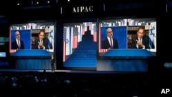 El primer ministro israelí, Benjamin Netanyahu, es visto en una pantalla en Washington, el lunes, 27 de marzo, de 2017, durante su discurso ante el Comité de Asuntos Públicos Estadounidense Israelí, vía satélite desde Israel.