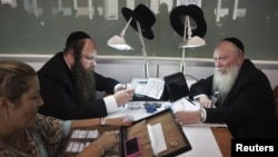Ultra-Orthodox Jews work in the trading room of Israel's diamond exchange in Ramat Gan near Tel Aviv, October 30, 2012.