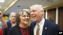 FILE -Greg Gianforte receives congratulations from a supporter, March 6, 2017, in Helena, Mont., after winning the Republican nomination for Montana's special election for U.S. House. The technology entrepreneur defeated Democratic nominee Rob Quist in the May 25 election.