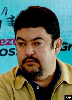 FILE - Roberto Marrero gives a press conference in Caracas, Dec. 8, 2015.