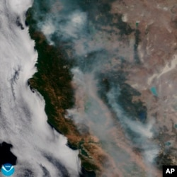 This satellite image released on Tuesday, Aug. 7, 2018 provided by NOAA shows the wildfires known as the Mendocino Complex, Calif. Northern California is grappling with the largest wildfire in California history.