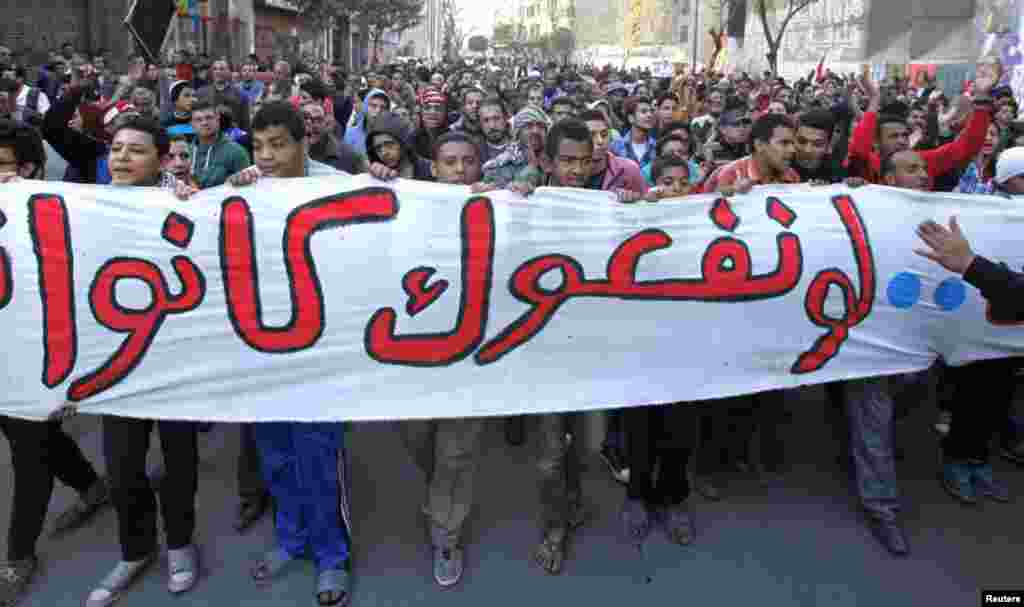 Protesters take part in a march during the second anniversary of the resignation of Hosni Mubarak, at Tahrir Square in Cairo, February 11, 2013.