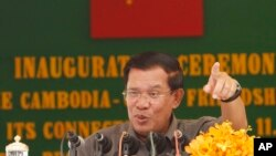 Cambodia's Prime Minister Hun Sen gestures as he delivers a speech during his presiding over an inauguration ceremony for the official use of a friendship bridge between Cambodia and China at Takhmau, Kandal provincial town south of Phnom Penh, Cambodia,