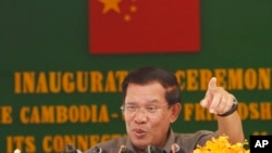 Cambodia's Prime Minister Hun Sen gestures as he delivers a speech during his presiding over an inauguration ceremony for the official use of a friendship bridge between Cambodia and China at Takhmau, Kandal provincial town south of Phnom Penh, Cambodia, file photo.