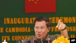 FILE: Cambodia's Prime Minister Hun Sen gestures during a speech at an inauguration ceremony for the official use of a friendship bridge between Cambodia and China at Takhmau, Kandal provincial town south of Phnom Penh, Cambodia, Monday, Aug. 3, 2015.