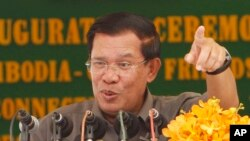 Cambodia's Prime Minister Hun Sen gestures as he delivers a speech during his presiding over an inauguration ceremony in Takhmau, Kandal provincial town south of Phnom Penh, Cambodia,