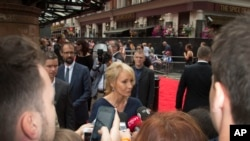 Writer J.K. Rowling talks to media upon arrival at the gala performance of Harry Potter and the Cursed Child, at the Palace Theatre in central London, Saturday, July 30, 2016.