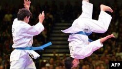 Turkey's team competes at the Men's Kata Team competition at the 22nd Karate World Championships on November 9, 2014, in Bremen, Germany. Karate is among the sports to be added to the 2020 Tokyo Games.