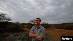 Game farmer Hennie Barnard looks out over his land near Aberdeen in the Karoo, South Africa, October 10, 2013.