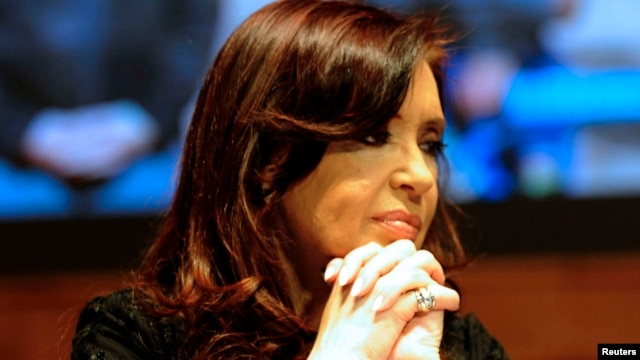 FILE - Argentine President Cristina Fernandez de Kirchner attends a rally in the San Juan province, Oct. 3, 2013.