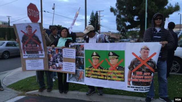 A crowd of Cambodian Americans rally against the visit of Lt. Gen. Hun Manet, Deputy Chairman of Joint Staff in the Royal Cambodian Armed Forces, and the eldest son of Prime Minister Hun Sen, in Long Beach, California, April 9, 2016.
